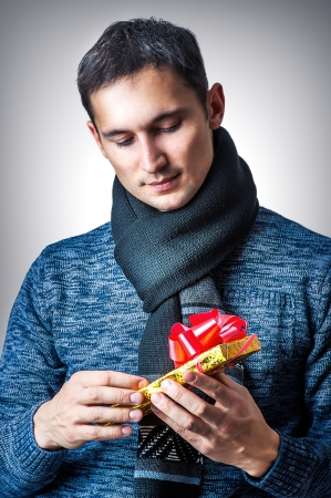 Young handsome casual man with christmas gift box Stock Photo - 16630159