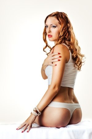 wristwatch: Young sexy beautiful woman in white cotton lingerie, wristwatch and bracelets