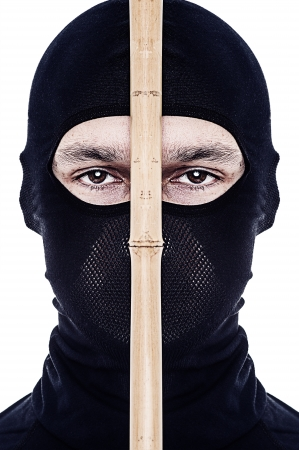 saboteur: Close up portrait of male ninja in black mask covered his face on white background Stock Photo