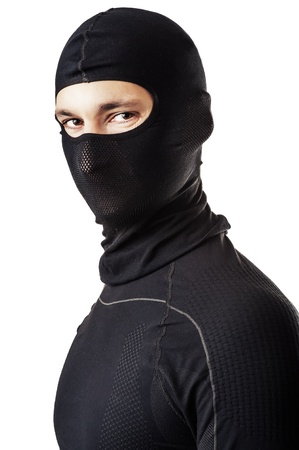 stealer: Young sexy man in black ski mask - balaclava