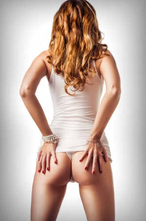 naked girl body: Perfect female body. Woman wearing white cotton undershirt and thong underwear with beautiful buttocks Stock Photo