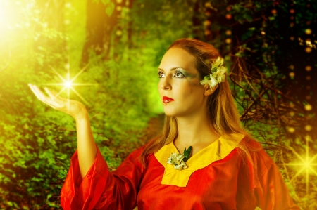 Fairytale. Young beautiful woman fairy in summer magic forest