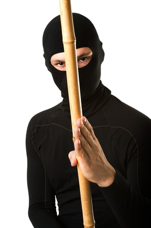 face guard: Close up portrait of male ninja in black mask covered his face on white background  Stock Photo