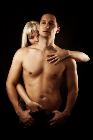 sex pose: Sexy couple of  lovers hugging. Woman kissing man to the neck