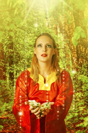 Fairytale  Young beautiful woman fairy in summer magic forest photo