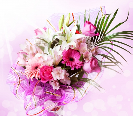 gentle pink and white spring flowers  Bouquet with red rose, alstroemeria, lily and gerberas on blur background photo