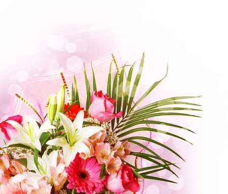 gentle pink and white spring flowers. Bouquet with red rose, alstroemeria, lily and gerberas on blur background photo
