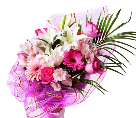 gentle pink and white spring flowers. Bouquet with red rose, alstroemeria, lily and gerberas isolated on white background photo