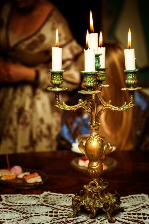 candle holders: Retro golden candlestick with five candles with flame Stock Photo