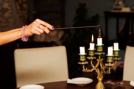 sniffer: Retro Brass Sniffer Bell for extinguishing candles in female hand