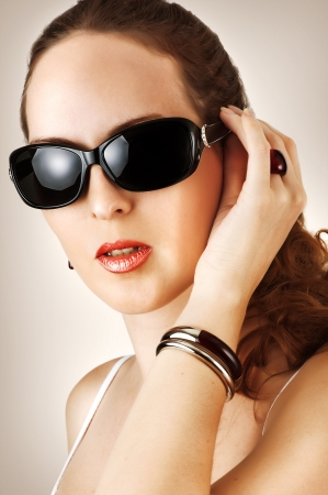 Young beautiful woman with fahion black glasses  photo