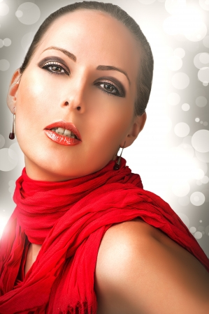 false teeth: Sexy beautiful woman with fashion make up and red scarf Stock Photo