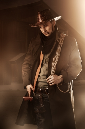 Young adult handsome man in cowboy clothes  Stock Photo