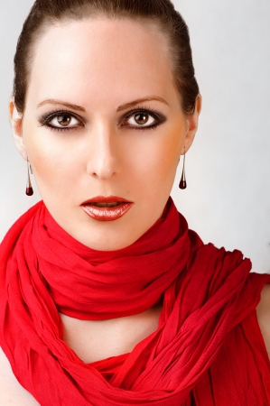 fashion make up: Sexy beautiful woman with fashion make up and red scarf Stock Photo