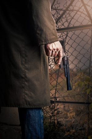 Male Hand with gun (revolver) outdoor. Stock Photo - 18787991