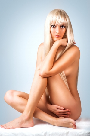 nude blonde woman: Beautiful sexy nude blonde woman sitting