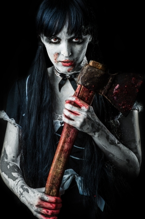 scary girl: Dead female zombie with bloody axe. Halloween concept Stock Photo