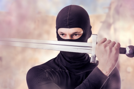 Close up portrait of male Ninja with sword outdoor  in smoke Stock Photo - 18847860