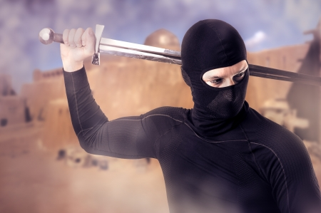 saboteur: Close up portrait of male Ninja with sword outdoor  in smoke