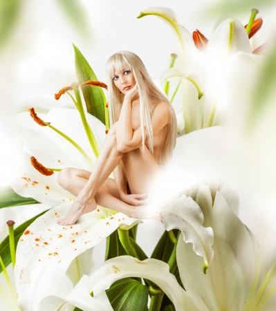 Beautiful sexy woman pixie sitting on a flower petal - white lily  Stock Photo - 19025470