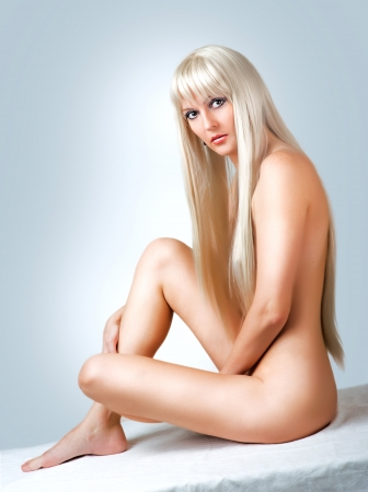 naked blonde: Beautiful sexy nude blonde woman sitting on white