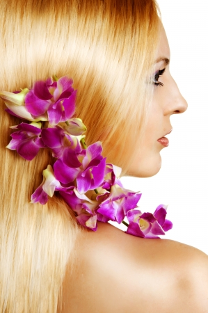 beauty sexy flower woman with natural make up on white background. Violet orchid photo