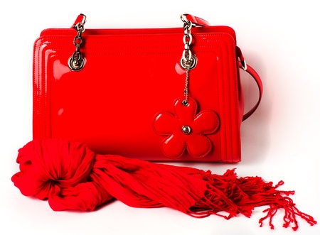 patent: Womens Accessories: red patent leather bag and scarf on white background