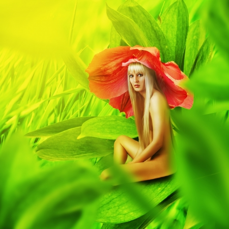 Fairy flower. Beautiful sexy nude woman sitting on a leaf of grass with red flower on her head Stock Photo - 19287413