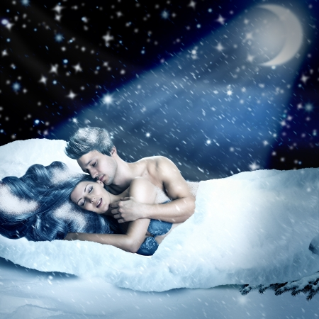 Fantasy romantic collage. Loving fairy couple  lying in bed of white snow outdoor in winter night. Tender Lovers have sex photo