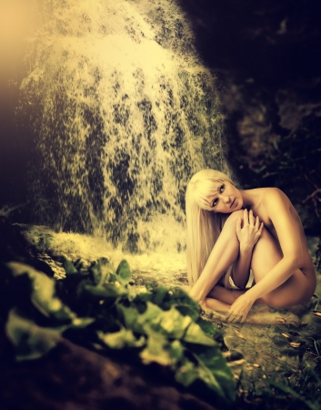 Beautiful fantasy summer landscape with lagoon, waterfall and sexy blond woman sitting in water