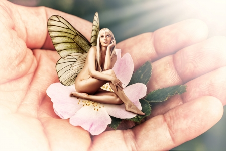 Beautiful sexy woman pixie with butterfly wings sitting on a tender pink flower in male hand