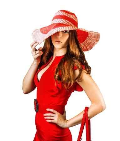 赤い帽子と服を着ている若いセクシーなファッショナブルな女性