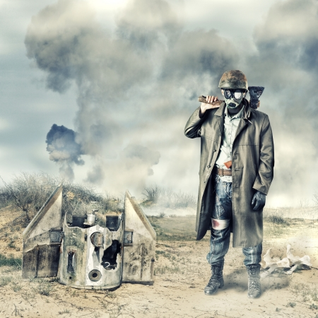 bandaged: Environmental disaster. Post apocalyptic survivor in gas mask holding axe Stock Photo