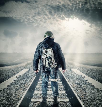 Environmental disaster. Post apocalyptic survivor in helmet holding hand gun 写真素材