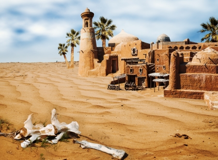 a mirage: bones in desert. Old fabulous city with palm trees - an oasis mirage Stock Photo
