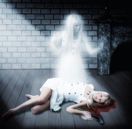 Fantasy Halloween concept of ghost. White transparent soul of woman sitting on floor next to her dead body photo