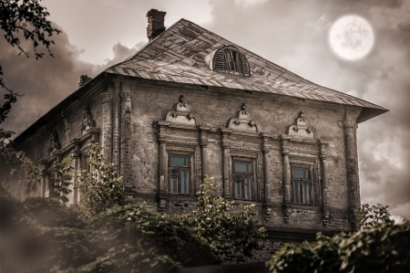 stucco house: Halloween concept. old abandoned empty house in forest Stock Photo