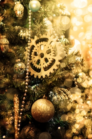 new year eve beads: Defocus Xmas background with golden Christmas decorationsl on  branches of fir tree