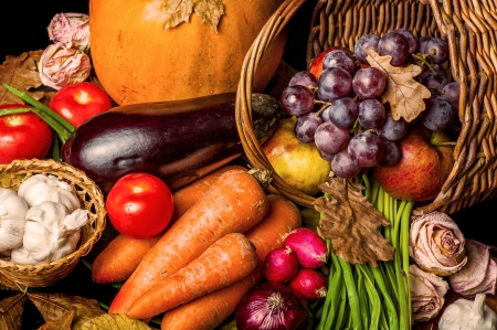 Beautiful autumn harvest of vegetables and leaves on black background  写真素材