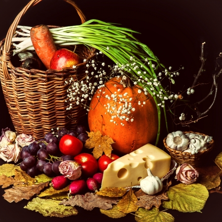 cornucopia: Beautiful autumn harvest of vegetables and leaves on black background  Stock Photo