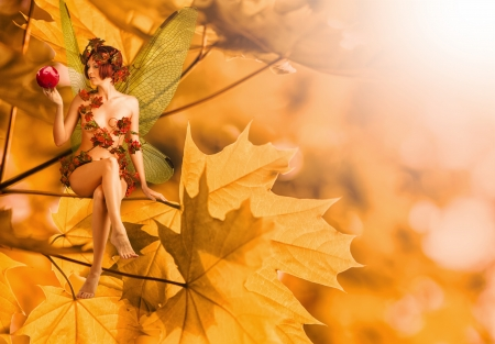 Young sexy woman - autumn fairy with wings sitting on orange leaves and she is holding ashberry