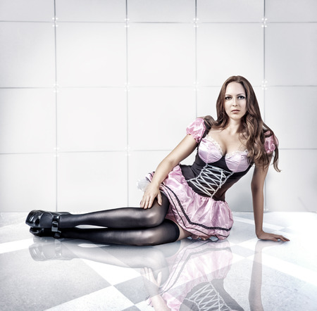 the girl in stockings: Fashion portrait of young sexy beautiful woman with long hair in dress