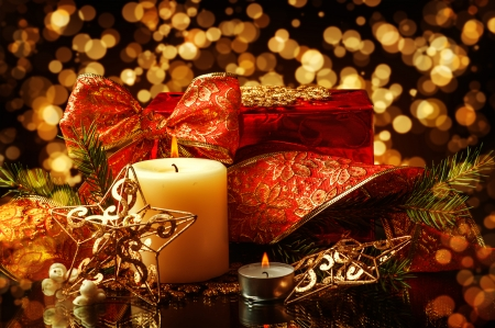 Christmas Decorations background for card - star, two candles and ribbon on fir tree branch photo