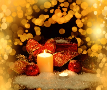 Gold Christmas Decorations background for card with candle photo