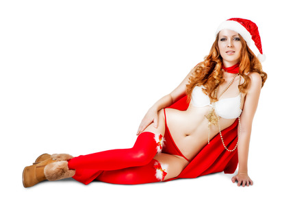stocking cap: Sexy christmas girl in red santa claus hat and bikini isolated on white