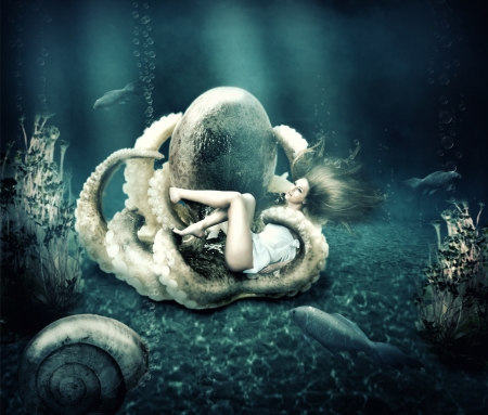 Fantasy underwater marine world. Octopus ensnares young beautiful woman with long hair photo