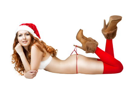 Sexy christmas girl in red santa claus hat and bikini isolated on white  photo