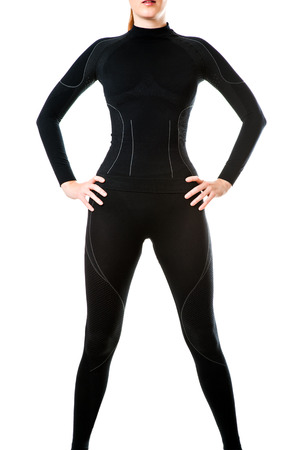 black ski pants: Fit sexy woman in black hot sports thermal underwear for downhill skiing isolated on white  Stock Photo