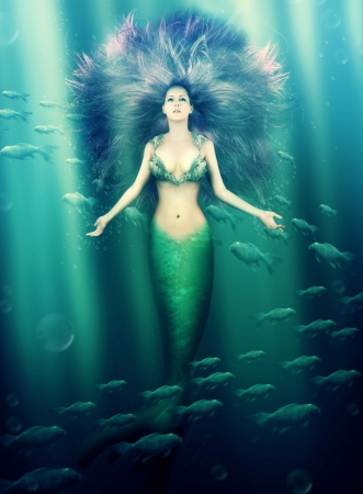 woman underwater: Fantasy  beautiful woman mermaid with fish tail and purple hair swimming in the sea under water