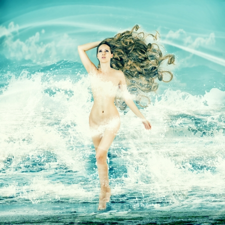fairy tale mermaid: Sexy fairy slim woman with long curly hair - Aphrodite is in sea water in a spray of sea waves Stock Photo